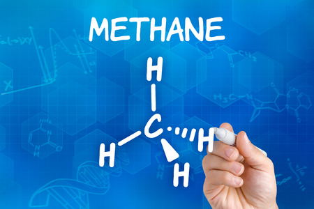 greenhouse effect: Hand with pen drawing the chemical formula of methane