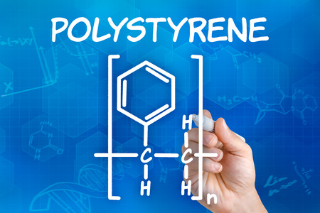 polystyrene: Hand with pen drawing the chemical formula of polystyrene