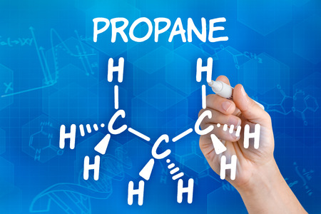 propane: Hand with pen drawing the chemical formula of propane