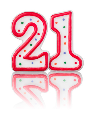 number candles: Red number 21 with reflection on a white background