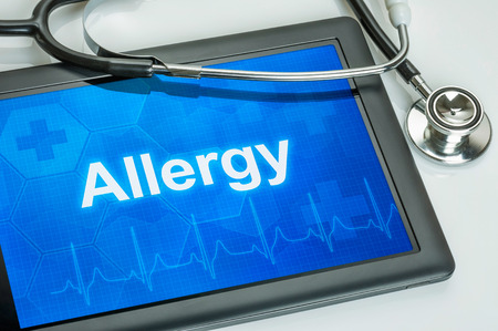 Tablet with the diagnosis allergy on the display photo