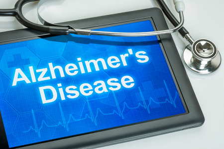 aging brain: Tablet with the diagnosis alzheimers disease on the display