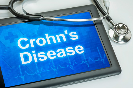 Tablet with the diagnosis Crohns disease on the display Stock Photo