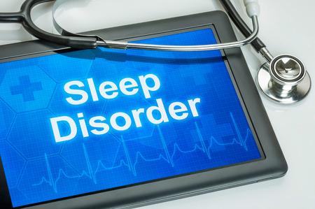 Tablette mit der Diagnose Schlafstörung auf dem Display