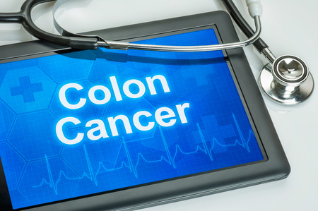 Tablet with the diagnosis colon cancer on the display photo