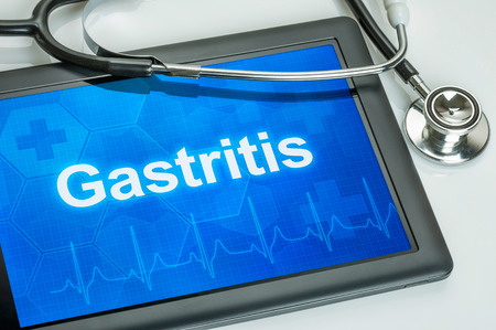 Tablet with the diagnosis gastritis on the display Stock Photo - 27354899