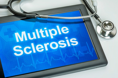 Tablet with the diagnosis multiple sclerosis on the display Фото со стока