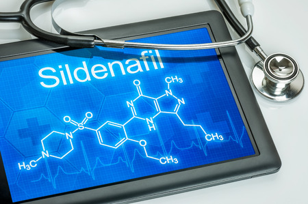dysfunction: Tablet with the chemical formula of sildenafil Stock Photo