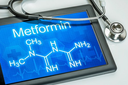 Tablet with the chemical formula of metformin photo