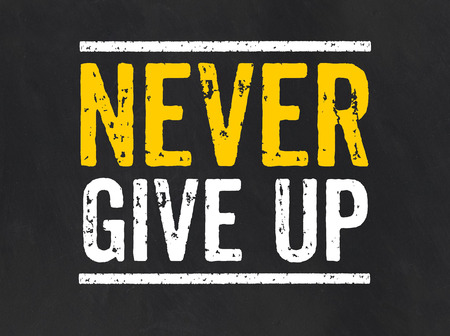 give: Blackboard with the text Never give up