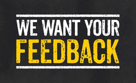 feedback: Blackboard with the text We want your feedback