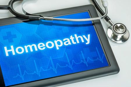 homeopatia: Tablet con la Homeopat�a texto en la pantalla Foto de archivo