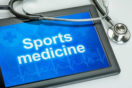 sports medicine: Tablet with the text Sports medicine on the display Stock Photo