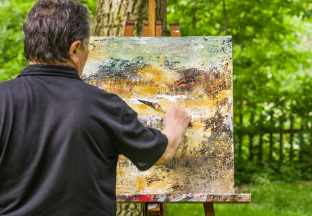 artist painting: Artist is painting an abstract picture