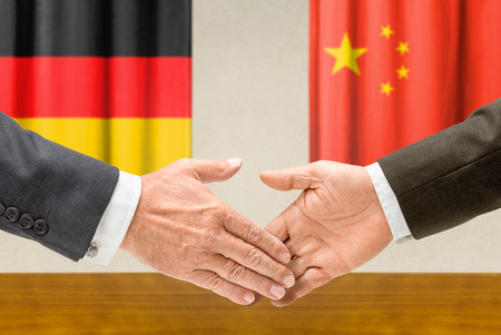 Representatives of Germany and China shake hands Stock Photo