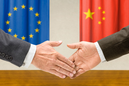 Representatives of the EU and China shake hands photo