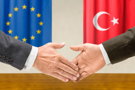 Representatives of the EU and Turkey shake hands photo