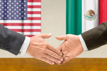 foreign policy: Representatives of the USA and Mexico shake hands