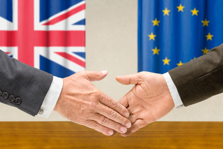 Representatives of the UK and the EU shake hands photo