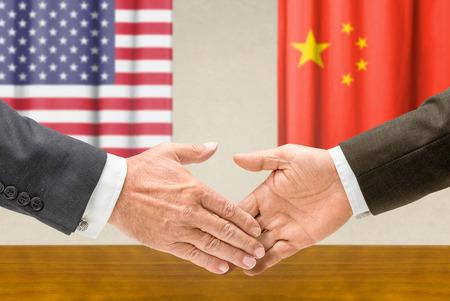 Representatives of the USA and China shake hands photo