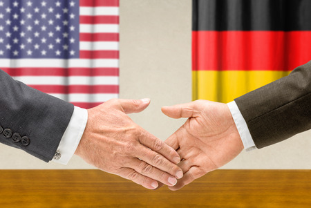 Representatives of the USA and Germany shake hands photo