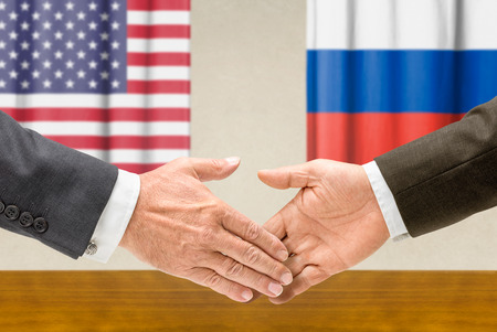 Representatives of the USA and Russia shake hands photo