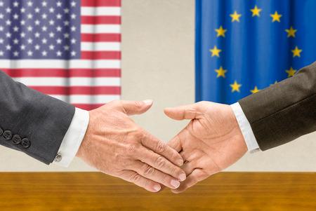 diplomats: Representatives of the USA and the EU shake hands