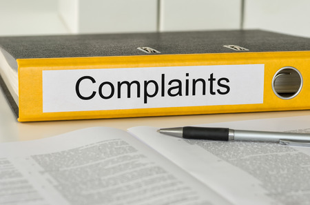 consumers: Folder with the label Complaints Stock Photo