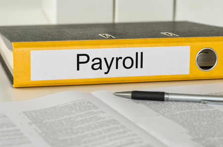 payroll: Folder with the label Payroll