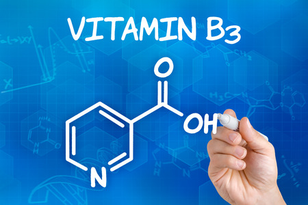 nicotinic: Hand with pen drawing the chemical formula of Vitamin B3