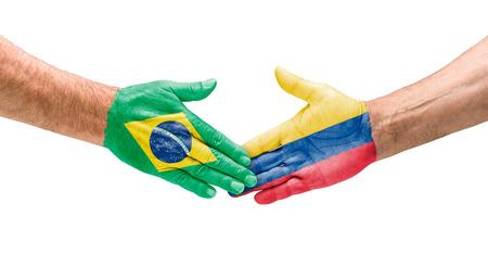 vs: Handshake Brazil and Colombia