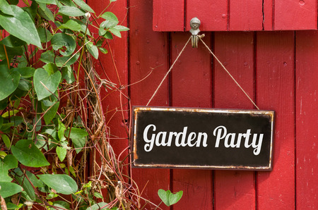 at sign: Old metal sign with the inscription Garden Party Stock Photo