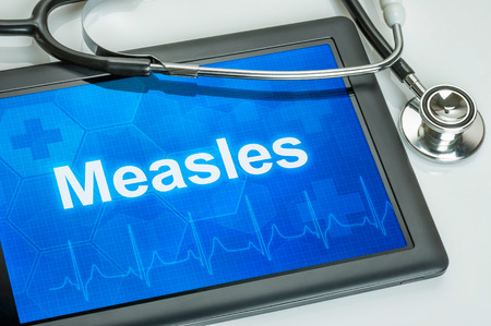 rash: Tablet with the diagnosis Measles on the display Stock Photo