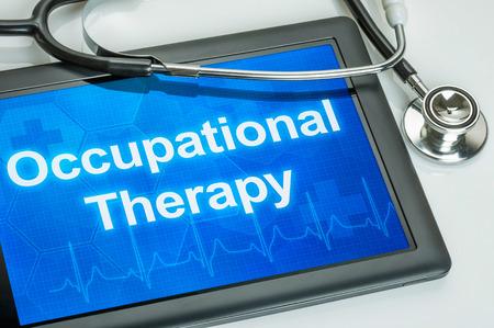ergotherapie: Tablet met de tekst Ergotherapie op het display Stockfoto