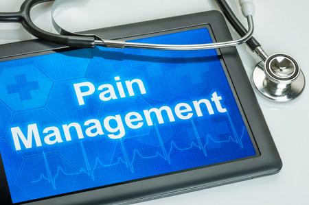 dolor: Tablet con el texto de Manejo del Dolor en la pantalla Foto de archivo