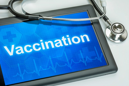 adjuvant: Tablet with the text Vaccination on the display Stock Photo