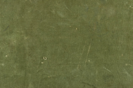 Olive green cotton texture with scratches ans rips