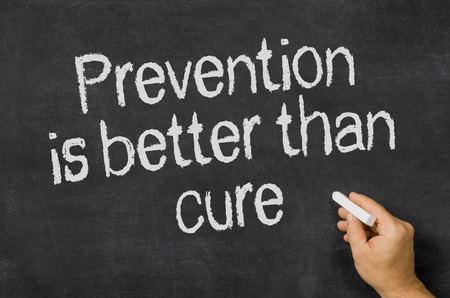 illness: Blackboard with the text Prevention is better than cure Stock Photo