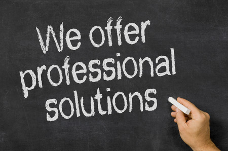 Blackboard with the text We offer professional solutions photo