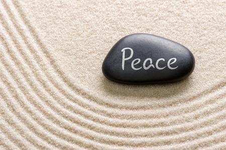 Black stone with the inscription Peace photo