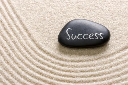Black stone with the inscription Success photo