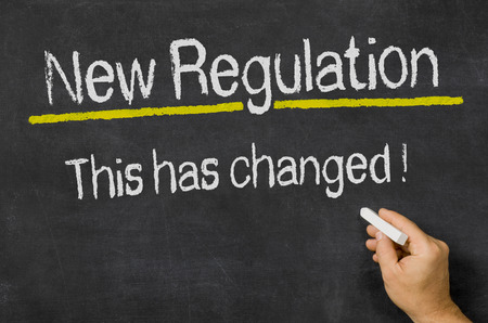 norm: Blackboard with the text New Regulation