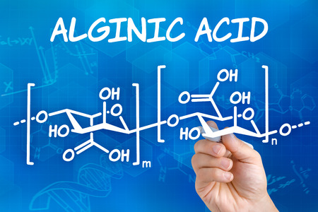 emulsifier: Hand with pen drawing the chemical formula of Alginic acid