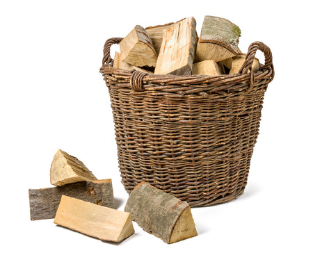 Wicker basket filled with firewood photo
