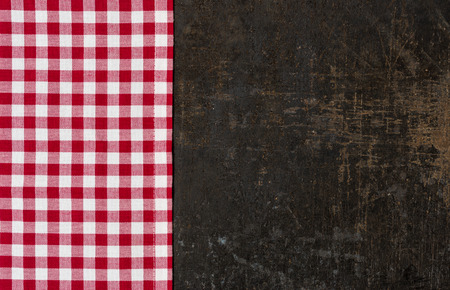 Antique baking tray with a red checkered tablecloth photo