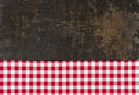 baking tray: Antique baking tray with a red checkered tablecloth Stock Photo