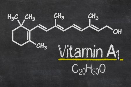 a1: Blackboard with the chemical formula of Vitamin A1 Stock Photo