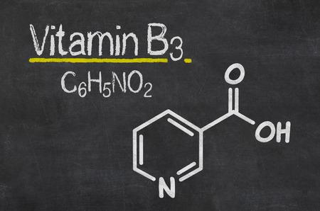 nicotinic: Blackboard with the chemical formula of Vitamin B3 Stock Photo