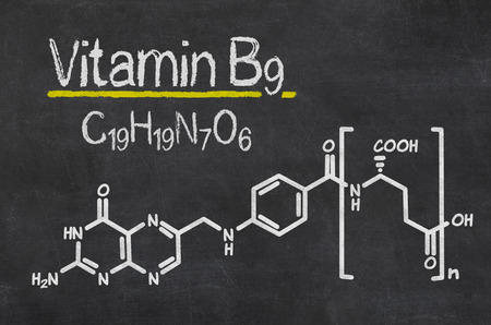 chemical formula: Blackboard with the chemical formula of Vitamin B9 Stock Photo