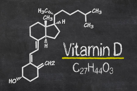 vitamins: Blackboard with the chemical formula of Vitamin D Stock Photo